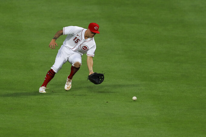 Cincinnati Reds' Nick Senzel (15) fields the ball hit for a single by Pittsburgh Pirates' Cole Tucker (3) in the fifth inning during a baseball game at in Cincinnati, Friday, Aug. 14, 2020. The Reds won 8-1. (AP Photo/Aaron Doster)