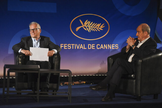 Cannes Festival director Thierry Fremaux, left, festival president Pierre Lescure, sit during the presentation of the festival lineup, in an empty cinema Wednesday, June 3, 2020 in Paris. The Cannes Film Festival was canceled due to the pandemic but it announced the films that would have played at the French Riviera festival. Those films, festival organizers say, will be able to promote themselves with the Cannes