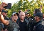 Russian President Vladimir Putin poses for a selfie with bikers during the Babylon's Shadow bike show camp near in Sevastopol, Crimea, Saturday, Aug. 10, 2019.  (Alexei Druzhinin, Sputnik, Kremlin Pool Photo via AP)