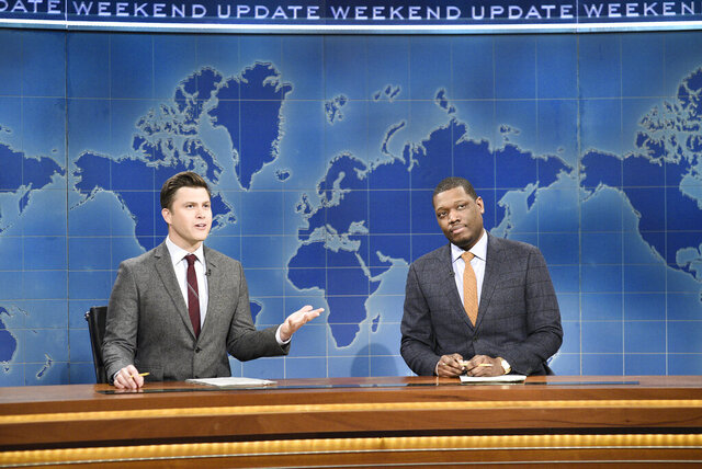 This Feb. 29, 2020 photo released by NBC shows Colin Jost, left, and Michael Che during the Weekend Update sketch on