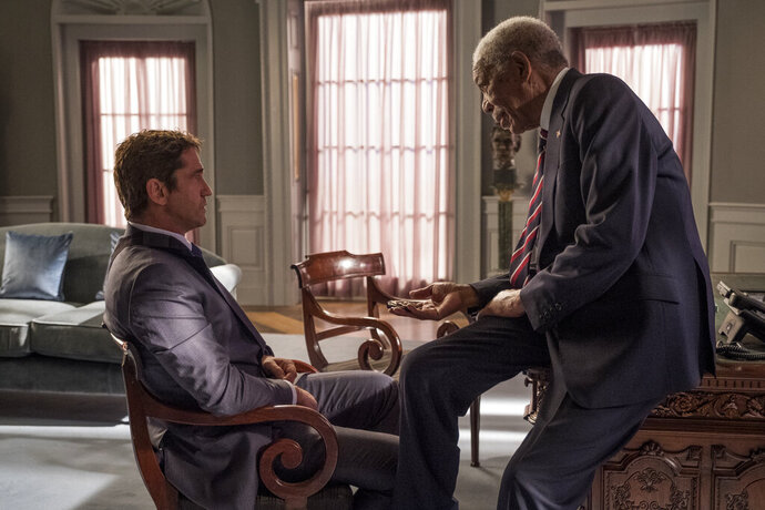 This image released by Lionsgate shows Gerard Butler, left and Morgan Freeman in