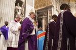 Pope Francis arrives in St. Peter's Basilica at the Vatican for a Mass with the Congolese community of Rome, Sunday, Dec. 1, 2019. (AP Photo/Alessandra Tarantino)