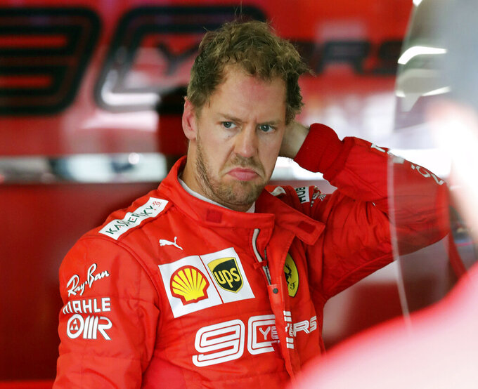 Ferrari driver Sebastian Vettel, of Germany, gets ready for the second practice session at the Formula One Canadian Grand Prix auto race, Friday, June 7, 2019, in Montreal. (Tom Boland/The Canadian Press via AP)