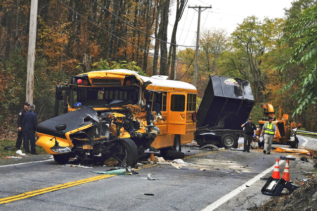 Law enforcement personnel work at the scene of a crash involving a school bus in New Windsor, N.Y. Wednesday, Oct. 21, 2020. (AP Photo/Paul Kazdan)