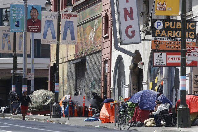 FILE - In this April 18, 2020, file photo, tents line a sidewalk on Golden Gate Avenue in San Francisco. A coalition in California is proposing legislation to boost taxes on wealthy multi-national corporations to raise more than $2 billion a year to end homelessness. Supporters say Assembly Bill 71, if approved, would