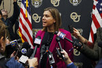 U.S. Rep. Elissa Slotkin, D-Mich., addresses the media after holding a constituent community conversation at Oakland University, Monday, Dec. 16, 2019, in Rochester, Mich. Slotkin, a freshman Democrat who flipped a battleground Republican seat, said Monday she will vote to impeach President Donald Trump.  (AP Photo/Carlos Osorio)