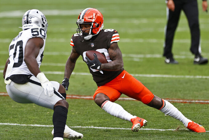 Cleveland Browns wide receiver Jarvis Landry (80) rushes against Las Vegas Raiders linebacker Nicholas Morrow (50) during the first half of an NFL football game, Sunday, Nov. 1, 2020, in Cleveland. (AP Photo/Ron Schwane)