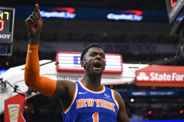 New York Knicks forward Bobby Portis (1) reacts during the first half of an NBA basketball game against the Washington Wizards, Saturday, Dec. 28, 2019, in Washington. (AP Photo/Nick Wass)