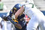 West Virginia defensive lineman Darius Stills (56) sheds the block of Baylor offensive lineman Connor Galvin (76)during an NCAA college football game, Saturday, Oct. 3, 2020, in Morgantown, W.Va. (William Wotring/The Dominion-Post via AP)