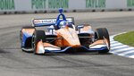 Scott Dixon, of New Zealand, takes the second turn during a practice session for the first race of the IndyCar Detroit Grand Prix auto racing doubleheader, Friday, May 31, 2019, in Detroit. (AP Photo/Carlos Osorio)