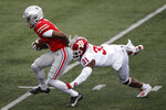 Ohio State receiver Garrett Wilson, runs after a catch past Indiana defensive back Bryant Fitzgerald during the first half of an NCAA college football game Saturday, Nov. 21, 2020, in Columbus, Ohio. (AP Photo/Jay LaPrete)