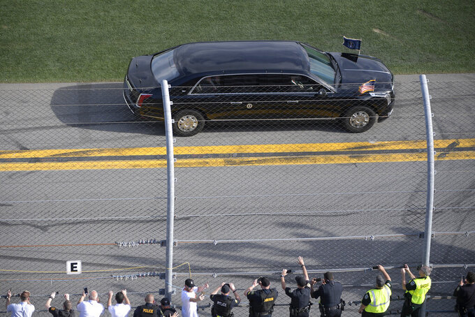 President Donald Trump's motorcade passes the grandstands as he leads the drivers around the track before the NASCAR Daytona 500 auto race at Daytona International Speedway, Sunday, Feb. 16, 2020, in Daytona Beach, Fla. (AP Photo/Phelan M. Ebenhack)