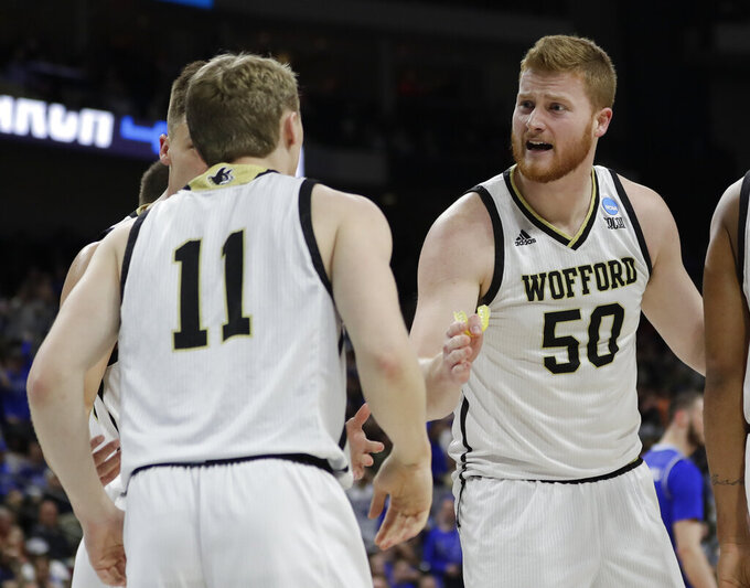 Wofford's Matthew Pegram (50) talks with teammates during the first half against Seton Hall in a first-round game in the NCAA men's college basketball tournament in Jacksonville, Fla., Thursday, March 21, 2019. (AP Photo/John Raoux)