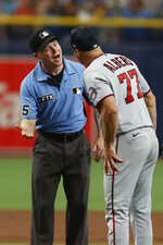 Minnesota Twins starting pitcher Andrew Albers (77) argues with umpire Junior Valentine after being called for a balk during the second inning of a baseball game against the Tampa Bay Rays, Saturday, Sept. 4, 2021, in St. Petersburg, Fla. (AP Photo/Scott Audette)