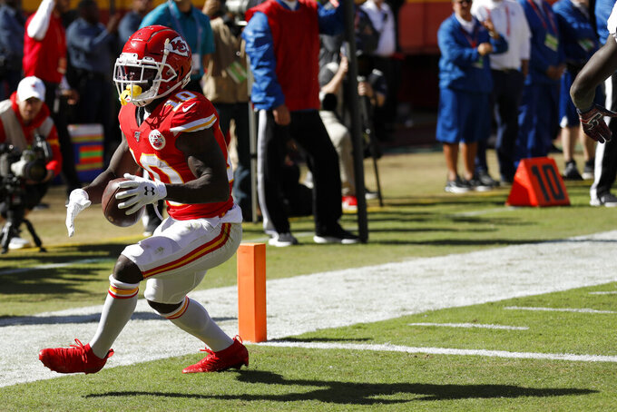 Kansas City Chiefs wide receiver Tyreek Hill (10) scores a touchdown during the second half of an NFL football game against the Houston Texans in Kansas City, Mo., Sunday, Oct. 13, 2019. (AP Photo/Colin E. Braley)