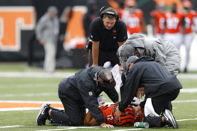 Cincinnati Bengals wide receiver Alex Erickson (12) lies on the field with an apparent injury in the first half of an NFL football game against the Arizona Cardinals, Sunday, Oct. 6, 2019, in Cincinnati. (AP Photo/Gary Landers)