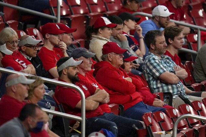 Fans watch a baseball game between the St. Louis Cardinals and the Pittsburgh Pirates Tuesday, May 18, 2021, in St. Louis. The Cardinals have significantly loosened their COVID-19 guidelines, saying fully vaccinated fans attending games at Busch Stadium will no longer be required to wear masks inside the ballpark. (AP Photo/Jeff Roberson)