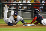 Houston Astros first baseman Yuli Gurriel forces out Washington Nationals' Trea Turner at first to end the seventh inning of Game 4 of the baseball World Series Saturday, Oct. 26, 2019, in Washington. (AP Photo/Patrick Semansky)