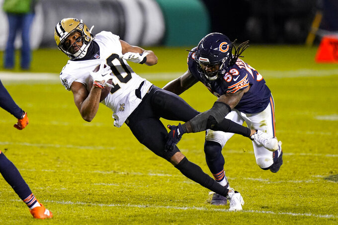 New Orleans Saints wide receiver Tre'Quan Smith (10) is tackled by Chicago Bears inside linebacker Danny Trevathan (59) after picking up a first down during overtime of an NFL football game in Chicago, Sunday, Nov. 1, 2020. (AP Photo/Nam Y. Huh)