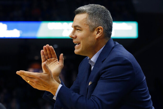 Virginia head coach Tony Bennett directs his team during the first half of an NCAA college basketball game against Virginia Tech in Charlottesville, Va., Saturday, Jan. 4, 2020. (AP Photo/Steve Helber)