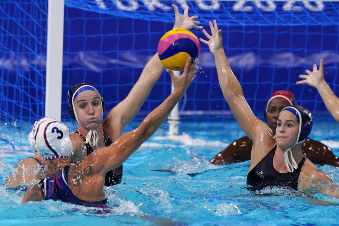 United States' Makenzie Fischer, second from left, and Rachel Fattal, right, defend against Ekaterina Prokofyeva (3), of the Russian Olympic Committee, during a semifinal round women's water polo match at the 2020 Summer Olympics, Thursday, Aug. 5, 2021, in Tokyo, Japan. (AP Photo/Mark Humphrey)