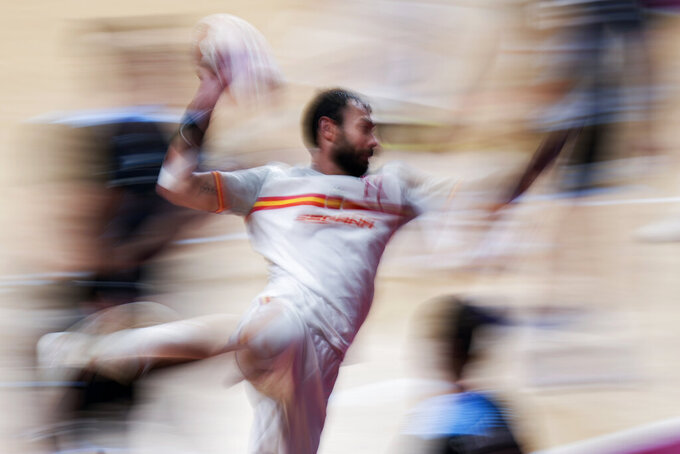 Spain's Daniel Sarmiento Melian scores during the men's preliminary round group A handball match between Spain and Argentina at the 2020 Summer Olympics, Sunday, Aug. 1, 2021, in Tokyo, Japan. (AP Photo/Pavel Golovkin)