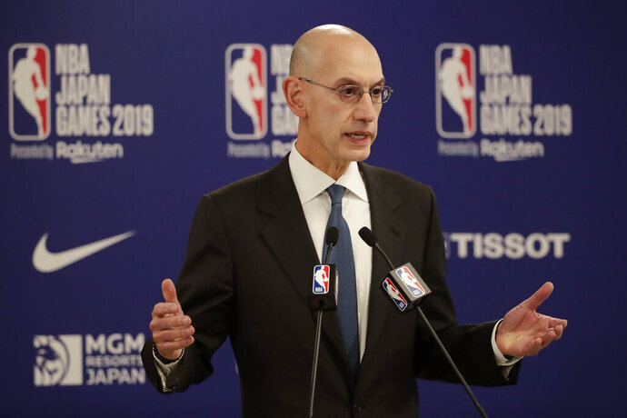 FILE - In this Oct. 8, 2019, file photo, NBA Commissioner Adam Silver speaks at a news conference before an NBA preseason basketball game between the Houston Rockets and the Toronto Raptors in Saitama, near Tokyo. It's been over three months since the commissioners of major sports cancelled or postponed events because of the coronavirus. Enough time for us to grade them on how they've handled the virus so far. (AP Photo/Jae C. Hong, File)