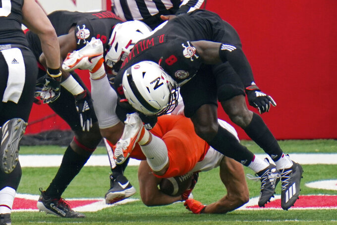 Illinois running back Chase Brown, bottom, scores a touchdown beneath Nebraska safety Deontai Williams (8), during the first half of an NCAA college football game in Lincoln, Neb., Saturday, Nov. 21, 2020. (AP Photo/Nati Harnik)