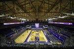 Players warm up for an NCAA college basketball game between Colorado and Washington on Wednesday, Jan. 20, 2021, in Seattle. (AP Photo/Joe Nicholson)