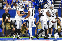 Oakland Raiders tight end Foster Moreau (87) celebrates his touchdown with wide receiver Tyrell Williams (16) during the first half of an NFL football game against the Indianapolis Colts in Indianapolis, Sunday, Sept. 29, 2019. (AP Photo/Doug McSchooler)