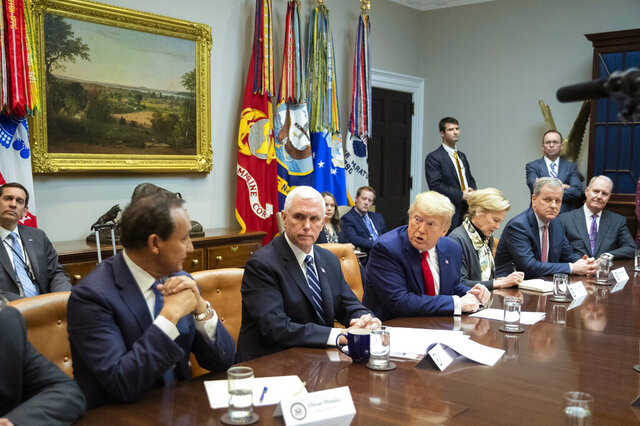 President Donald Trump with, from left, United Airlines CEO Oscar Munos, Vice President Mike Pence, Trump, White House coronavirus response coordinator Dr. Deborah Birx, American Airlines CEO Doug Parker, Southwest CEO Gary Kelly, speaks during a coronavirus briefing with Airline CEOs in at the Roosevelt Room of the White House, Wednesday, March 4, 2020, in Washington. (AP Photo/Manuel Balce Ceneta)