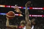 United States' Harrison Barnes at right blocks Japan's Rui Hachimura during a Group E match for the FIBA Basketball World Cup at the Shanghai Oriental Sports Center in Shanghai on Thursday, Sept. 5, 2019. (AP Photo/Ng Han Guan)
