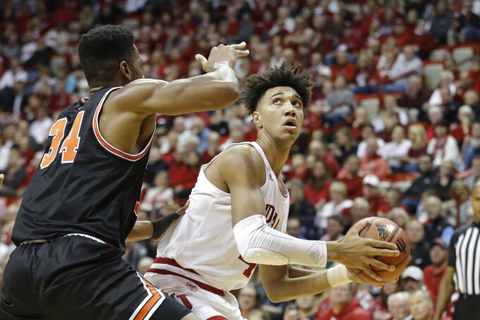 Indiana's Trayce Jackson-Davis (4) looks for a shot as Princeton's Richmond Aririguzoh (34) defends during the first half of an NCAA college basketball game Wednesday, Nov. 20, 2019, in Bloomington, Ind. (AP Photo/Darron Cummings)