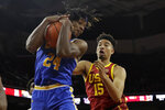 UCLA forward Jalen Hill (24) grabs a rebound next to Southern California forward Isaiah Mobley (15) during the first half of an NCAA college basketball game Saturday, March 7, 2020, in Los Angeles. (AP Photo/Marcio Jose Sanchez)