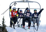 Fans of the New England Patriots NFL football team share a chairlift at the Sugarloaf ski resort, Sunday, Feb. 3, 2019, in Carrabassett Valley, Maine. About 200 skiers took part to show their support for the Patriots prior to today's Super Bowl game against the Los Angeles Rams. (AP Photo/Robert F. Bukaty)