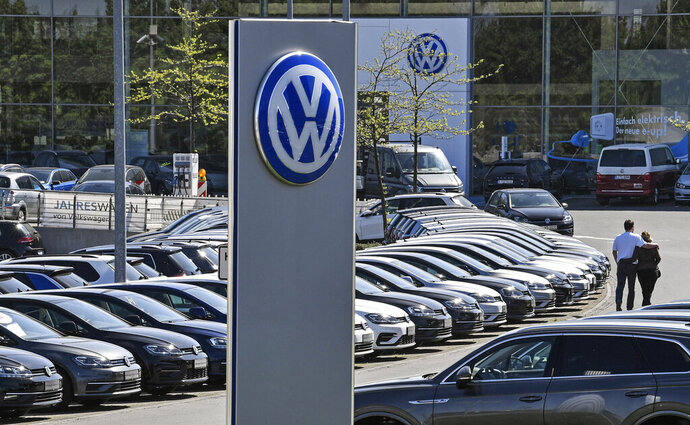 FILE - In this Monday, April 20, 2020 file photo, cars are lined up at a Volkswagen car dealer in Essen, Germany. German automaker Volkswagen says it returned to profit in the third quarter thanks to cost discipline and a rebound in global sales markets led by China after the lifting of the severe restrictions on activity in the early phase of the pandemic. (AP Photo/Martin Meissner, File)