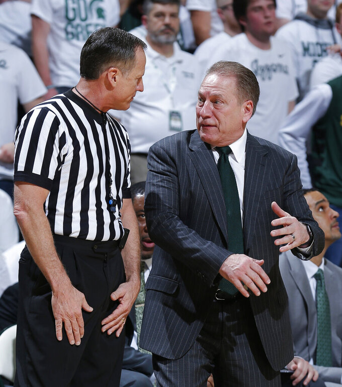 Michigan State coach Tom Izzo has words with a referee during the first half of the team's NCAA college basketball game against Michigan, Saturday, March 9, 2019, in East Lansing, Mich. (AP Photo/Al Goldis)
