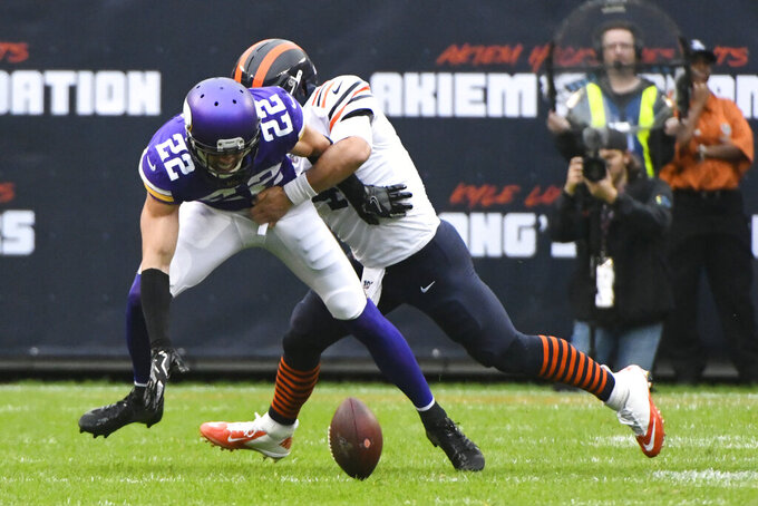 Minnesota Vikings free safety Harrison Smith reaches for a fumble as Chicago Bears quarterback Chase Daniel defends during the half of an NFL football game Sunday, Sept. 29, 2019, in Chicago. The Bears recovered the fumble. (AP Photo/Matt Marton)
