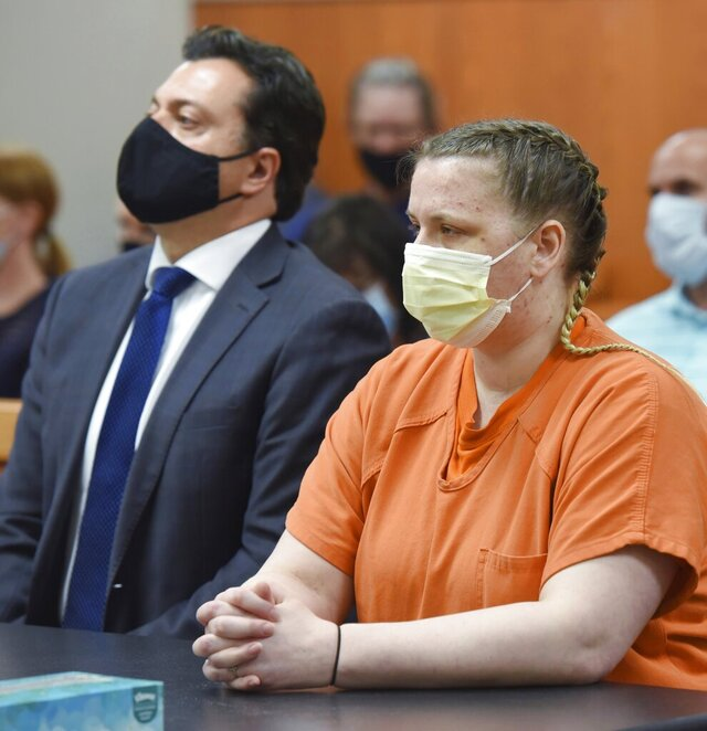 JoAnn Cunningham, accompanied by her public defender, Angelo Mourelatos listens as she is sentenced to 35 years in prison, Friday, July 17, 2020, in Woodstock, Ill., for beating her five-year-old son to death last year. (John Starks/Daily Herald via AP)