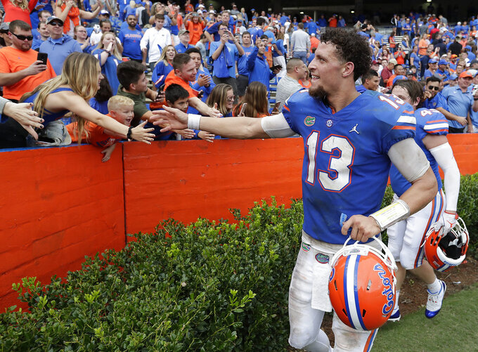 Florida quarterback Feleipe Franks (13) celebrates with fans after defeating South Carolina in an NCAA college football game, Saturday, Nov. 10, 2018, in Gainesville, Fla. (AP Photo/John Raoux)