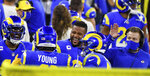 Los ANgeles Rams outside linebacker Kenny Young celebrates with defensive end Aaron Donald after intercepting a pass and running for a touchdown against the New England Patriots in the first half of an NFL football game in Inglewood, Calif., Thursday, Dec. 10, 2020. (Keith Birmingham/The Orange County Register via AP)