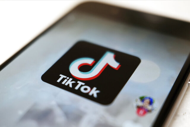 "FILE - This Monday, Sept. 28, 2020, file photo, shows as  logo of a smartphone app TikTok on a user post on a smartphone screen in Tokyo. Canadian e-commerce platform Shopify said Tuesday, Oct. 27, 2020, it's made a deal with TikTok enabling merchants to create ""shoppable"" video ads that drive customers to online stores. (AP Photo/Kiichiro Sato, File)"