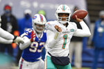 Miami Dolphins quarterback Tua Tagovailoa passes in the first half of an NFL football game against the Buffalo Bills, Sunday, Jan. 3, 2021, in Orchard Park, N.Y. (AP Photo/Adrian Kraus)