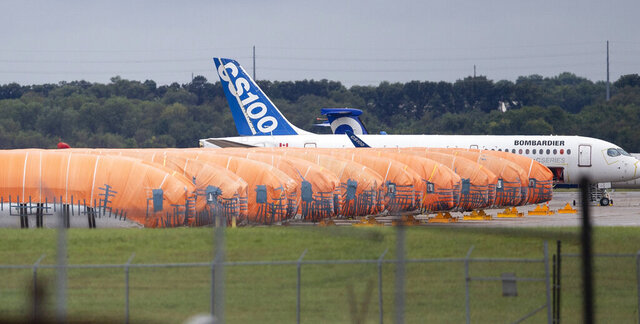 FILE - In this Oct. 3, 2019, file photo completed Boeing 737 MAX fuselages, made at Spirit Aerosystems in Wichita, Kan., sit covered in tarps near the factory. On Friday, Jan. 10, 2020, aircraft parts maker Spirit AeroSystems announced it is laying off 2,800 employees at its Wichita facility due to the grounding of the Boeing 737 Max. (Travis Heying/The Wichita Eagle via AP, File)