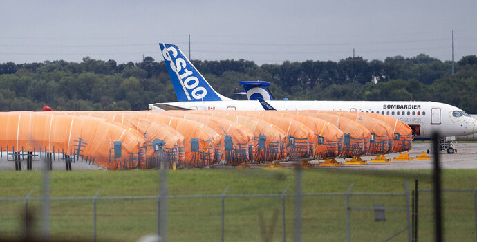 FILE - In this Oct. 3, 2019, file photo completed Boeing 737 MAX fuselages, made at Spirit Aerosystems in Wichita, Kan., sit covered in tarps near the factory. On Friday, Jan. 10, 2020, aircraft parts maker Spirit AeroSystems announced it is laying off 2,800 employees at its Wichita facility due to the grounding of the Boeing 737 Max.(Travis Heying/The Wichita Eagle via AP, File)