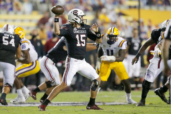 South Carolina quarterback Collin Hill (15) throws against LSU during the second half of an NCAA college football game in Baton Rouge, La., Saturday, Oct. 24, 2020. (AP Photo/Brett Duke)