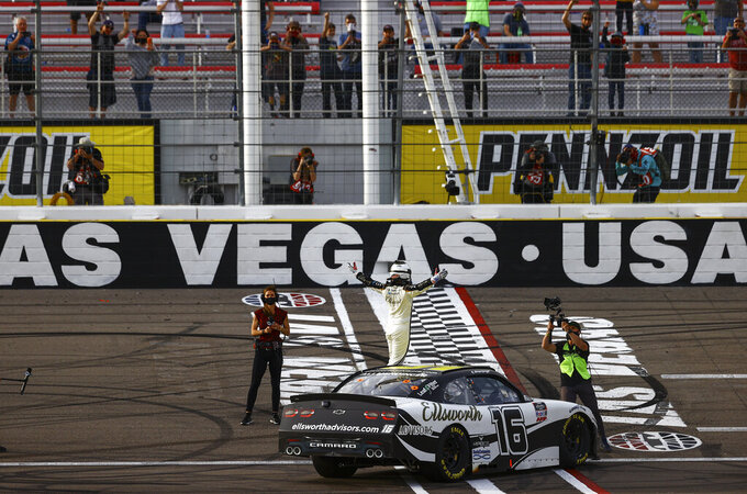 AJ Allmendinger, center, celebrates after winning a NASCAR Xfinity Series auto race at Las Vegas Motor Speedway, Saturday, March 6, 2021. (Chase Stevens/Las Vegas Review-Journal via AP)