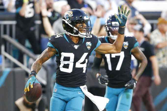 Jacksonville Jaguars wide receiver Keelan Cole (84) celebrates a touchdown reception against the Indianapolis Colts during the first half of an NFL football game, Sunday, Dec. 29, 2019, in Jacksonville, Fla. (AP Photo/Stephen B. Morton)