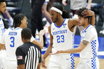 Kentucky's Brandon Boston Jr. (3), Isaiah Jackson (23) and Dontaie Allen, right, celebrate after a score against Mississippi State in the second half of an NCAA college basketball game in the Southeastern Conference Tournament Thursday, March 11, 2021, in Nashville, Tenn. (AP Photo/Mark Humphrey)
