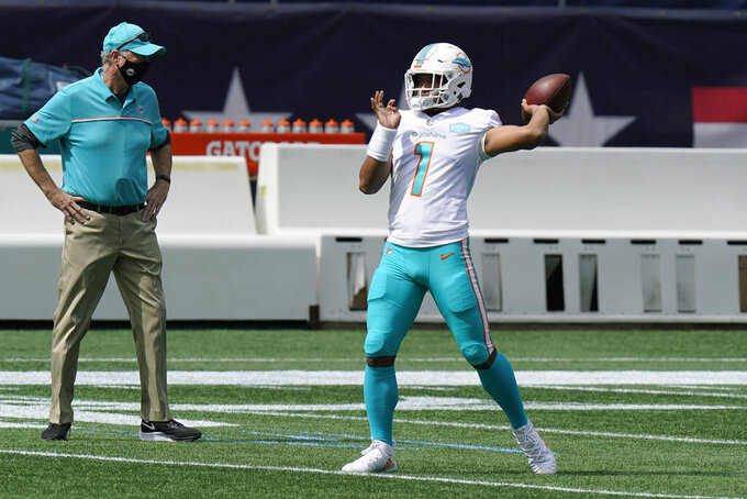FILE - Miami Dolphins quarterback Tua Tagovailoa warms up before an NFL football game against the New England Patriots, Sunday, Sept. 13, 2020, in Foxborough, Mass. The Dolphins' self-professed placeholder at quarterback played like one in the season opener, amplifying questions about the team's timetable for turning to rookie Tua Tagovailoa. Veteran Ryan Fitzpatrick threw three interceptions in Miami's loss at New England.(AP Photo/Steven Senne, File)